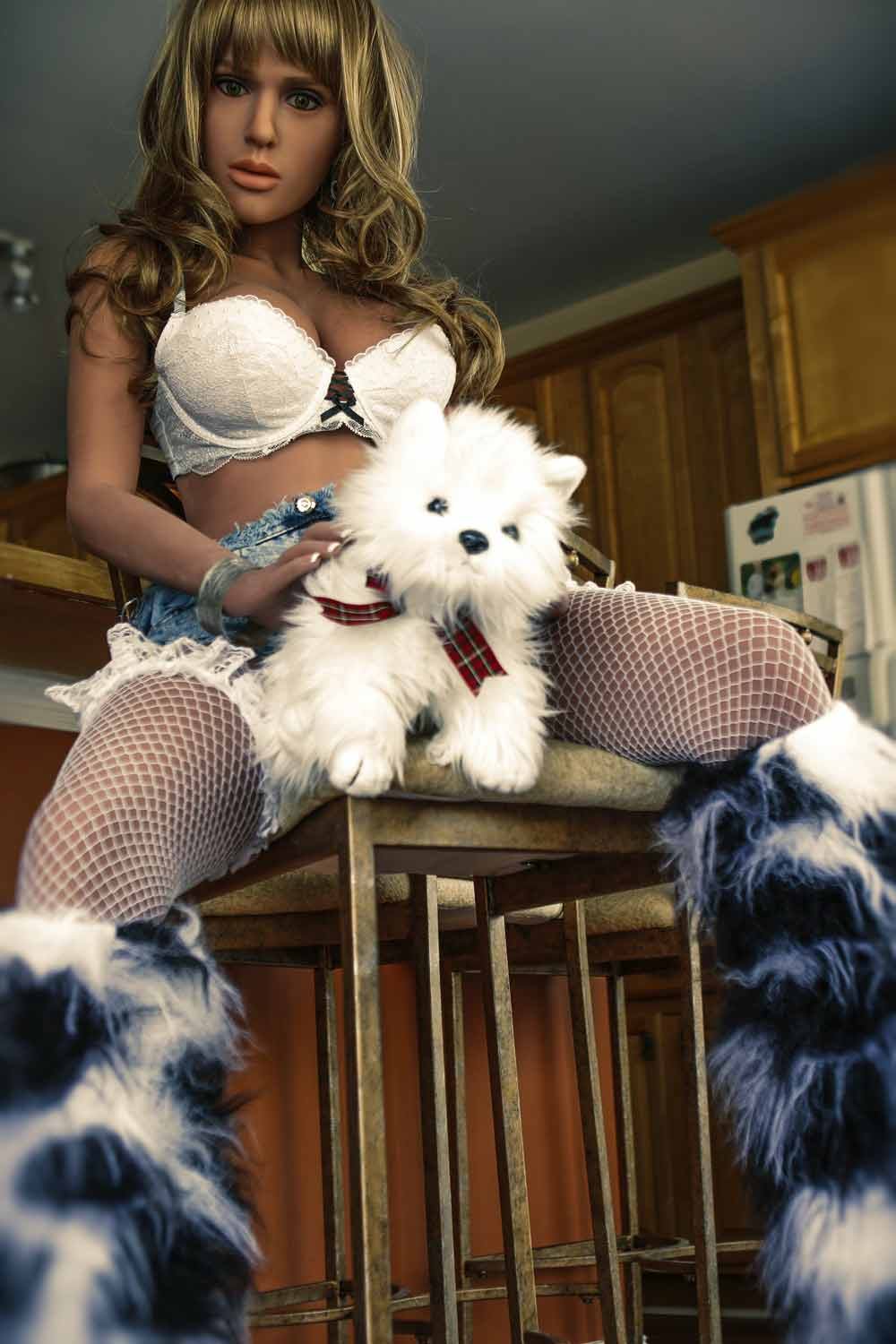 Sex doll with dog between thighs