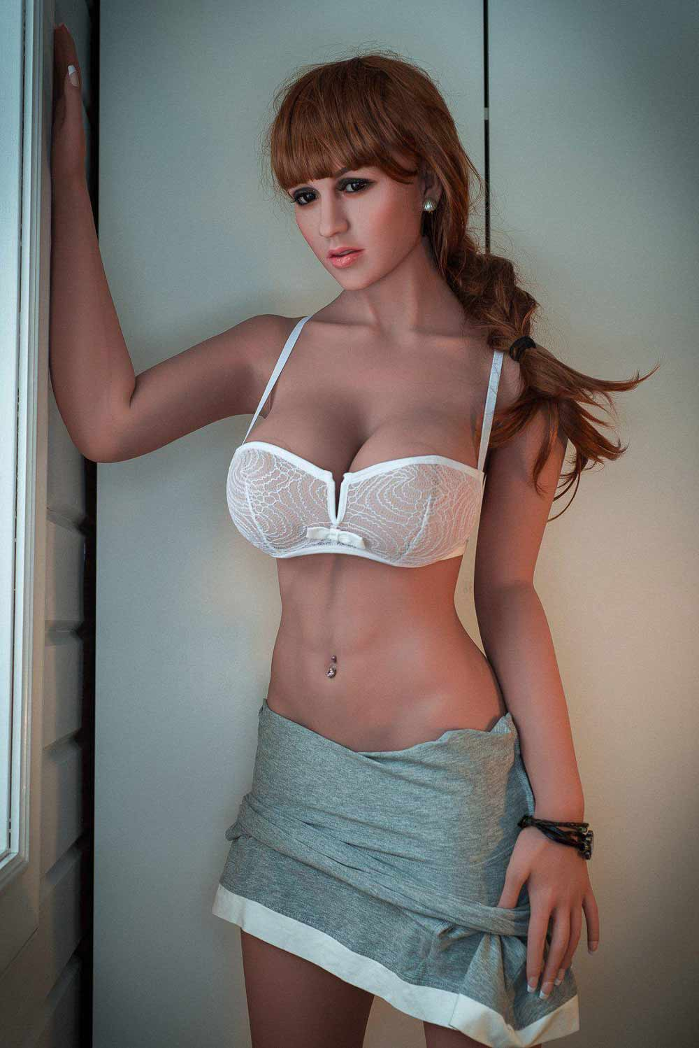 Sex doll with hands on the window