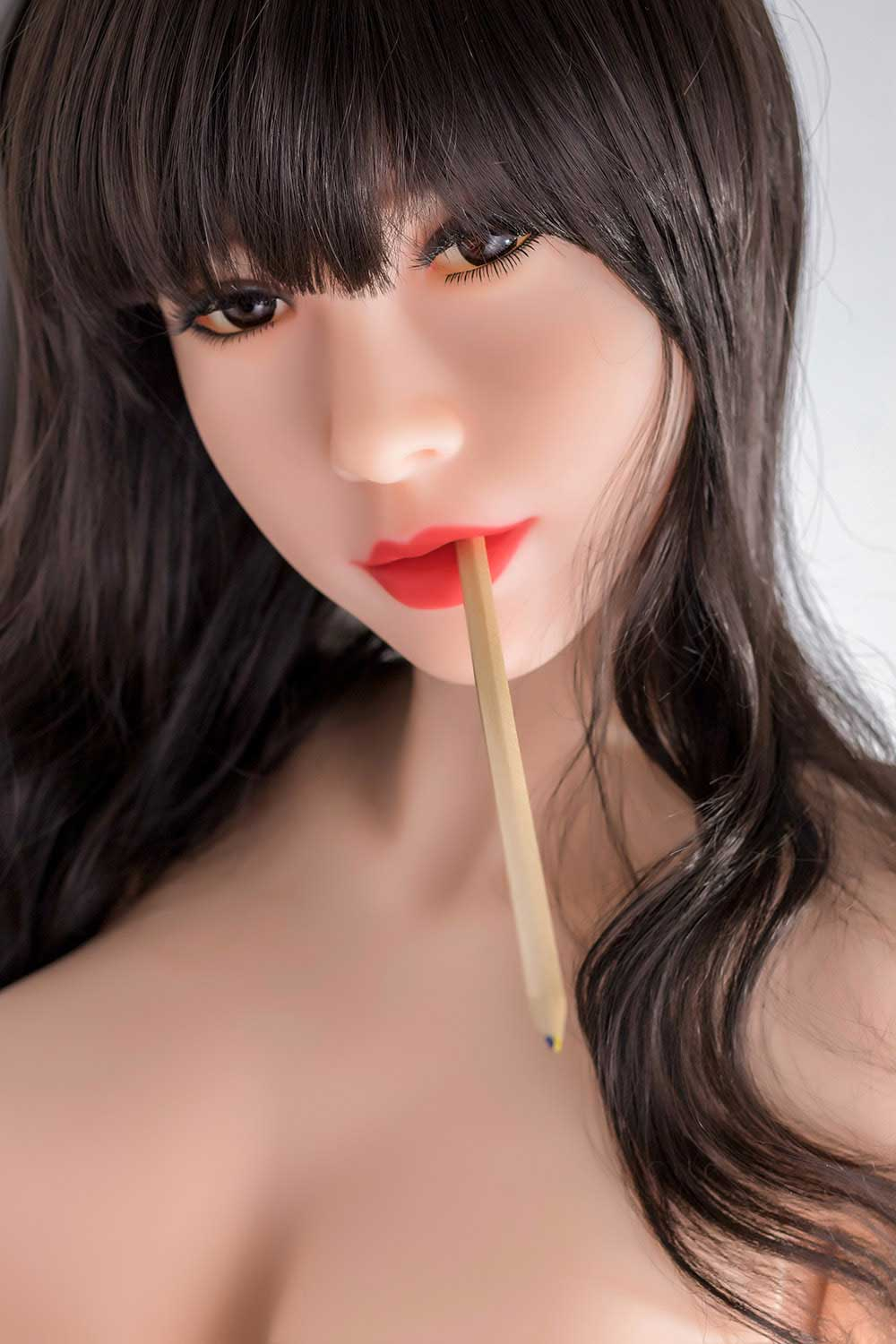Sex doll with pen in mouth