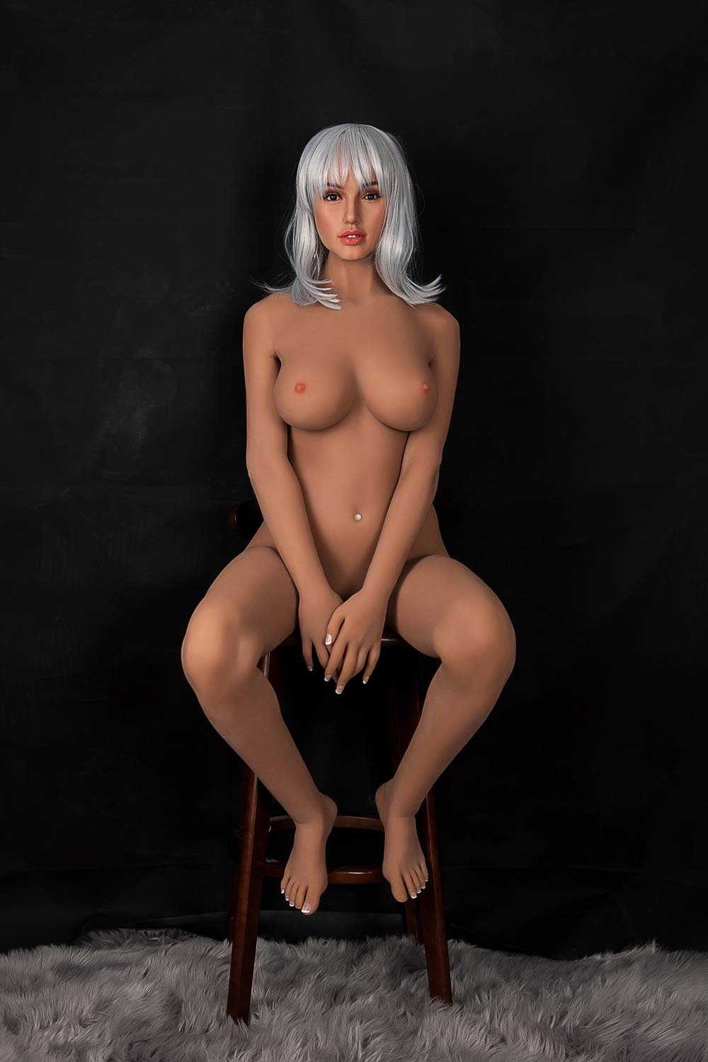 Silicone sex doll with hands blocking the vagina
