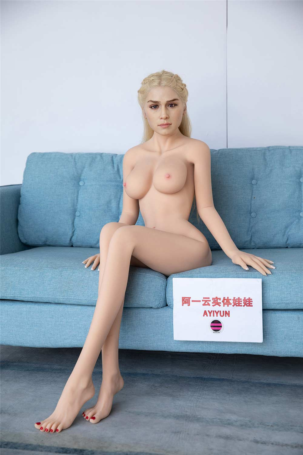 Silicone Sex Doll Sitting On The Sofa