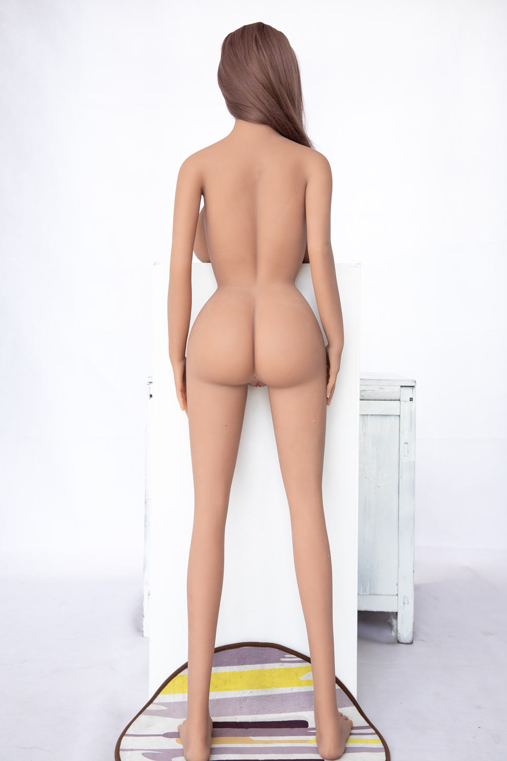 A sex doll with naked ass