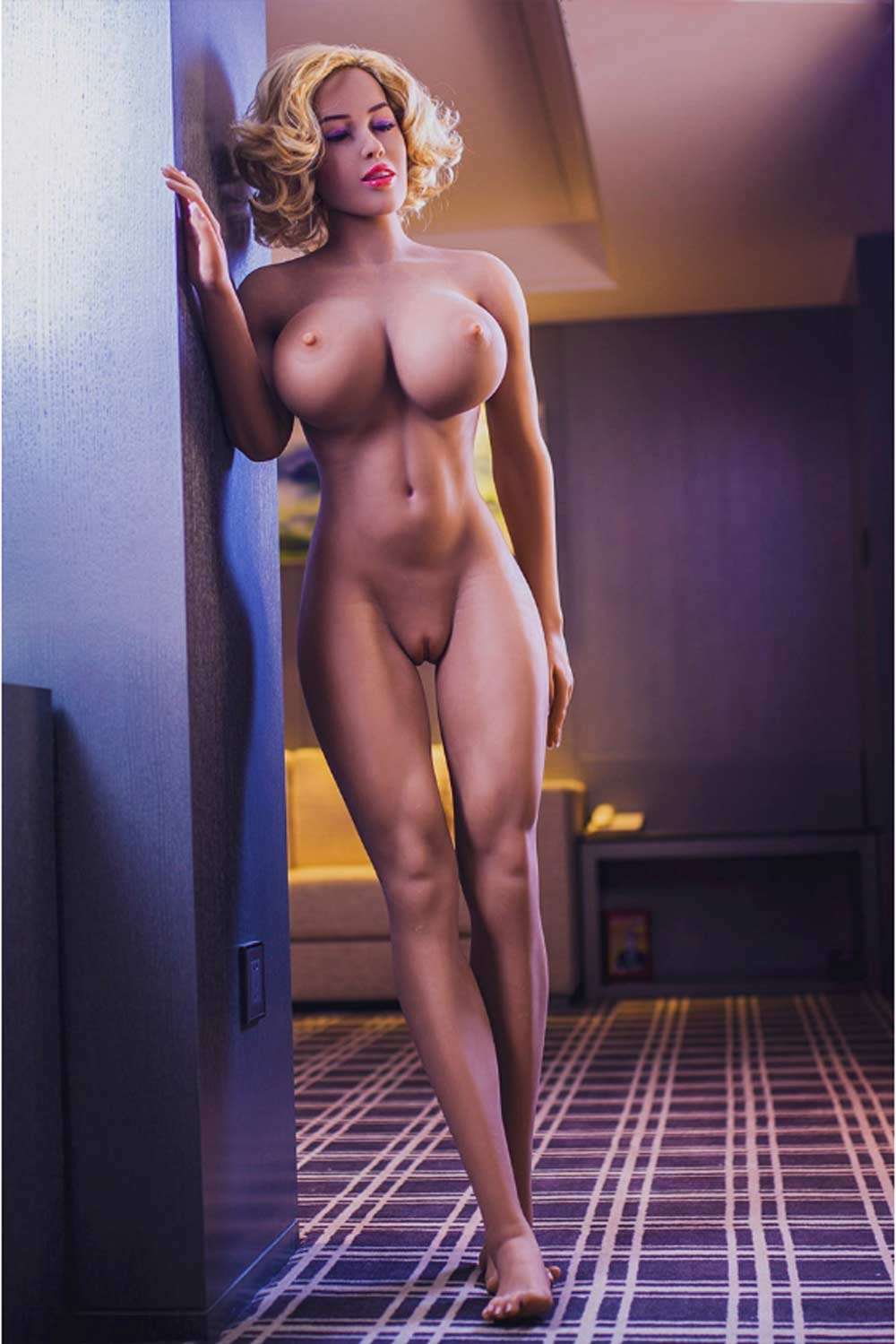Big breasted sex doll holding on to the wall