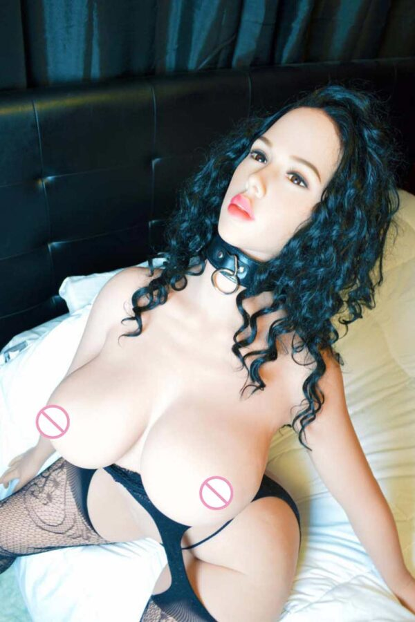 Big breasted sex doll wearing a collar