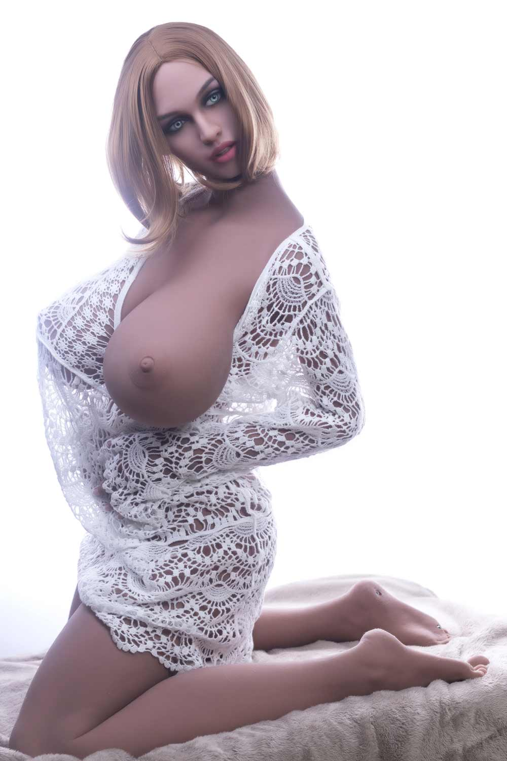 Big breasted sex doll with breasts protruding from clothes