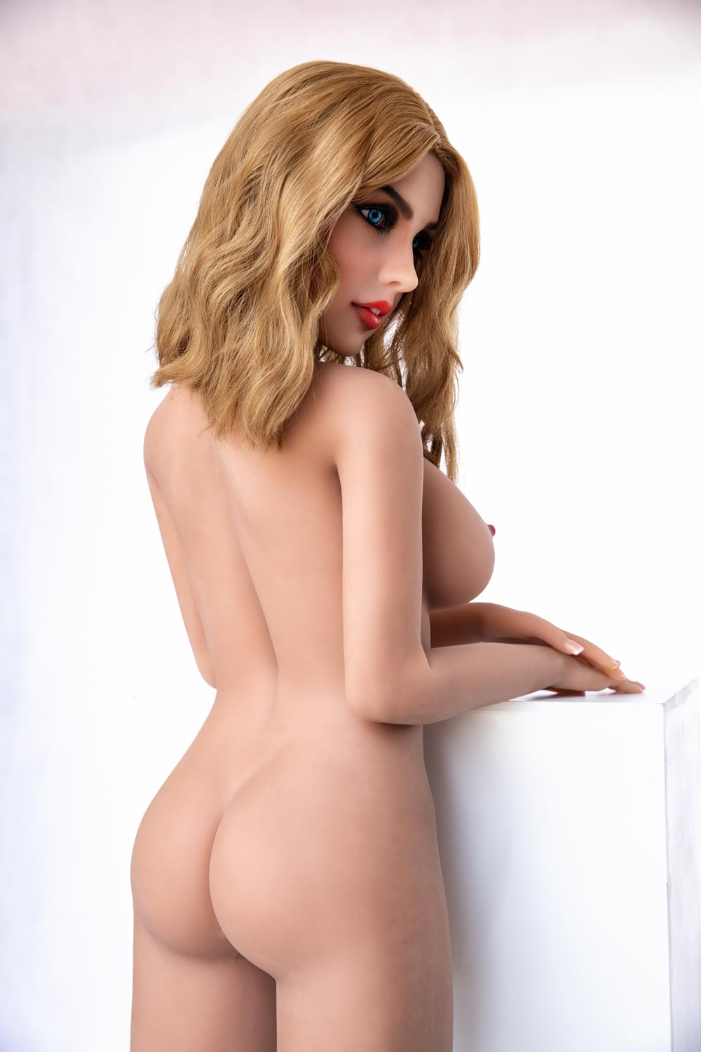 Big breasted sex doll with naked ass