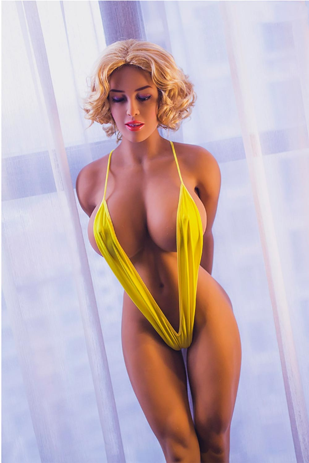 Big breasted sex doll with short blond hair