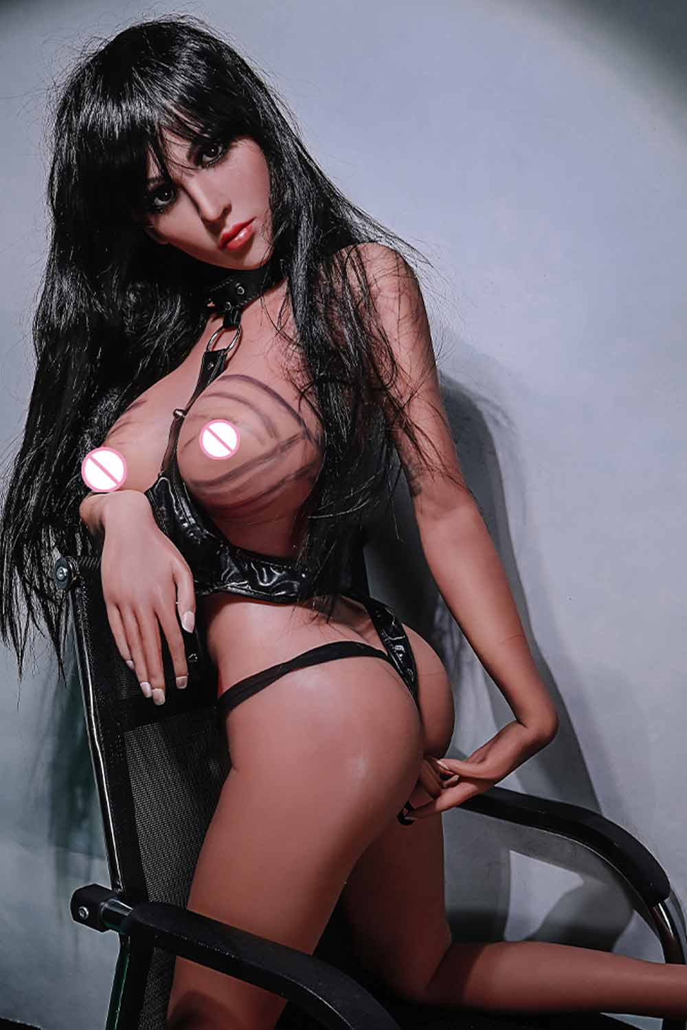 Sex doll with hands beside anus