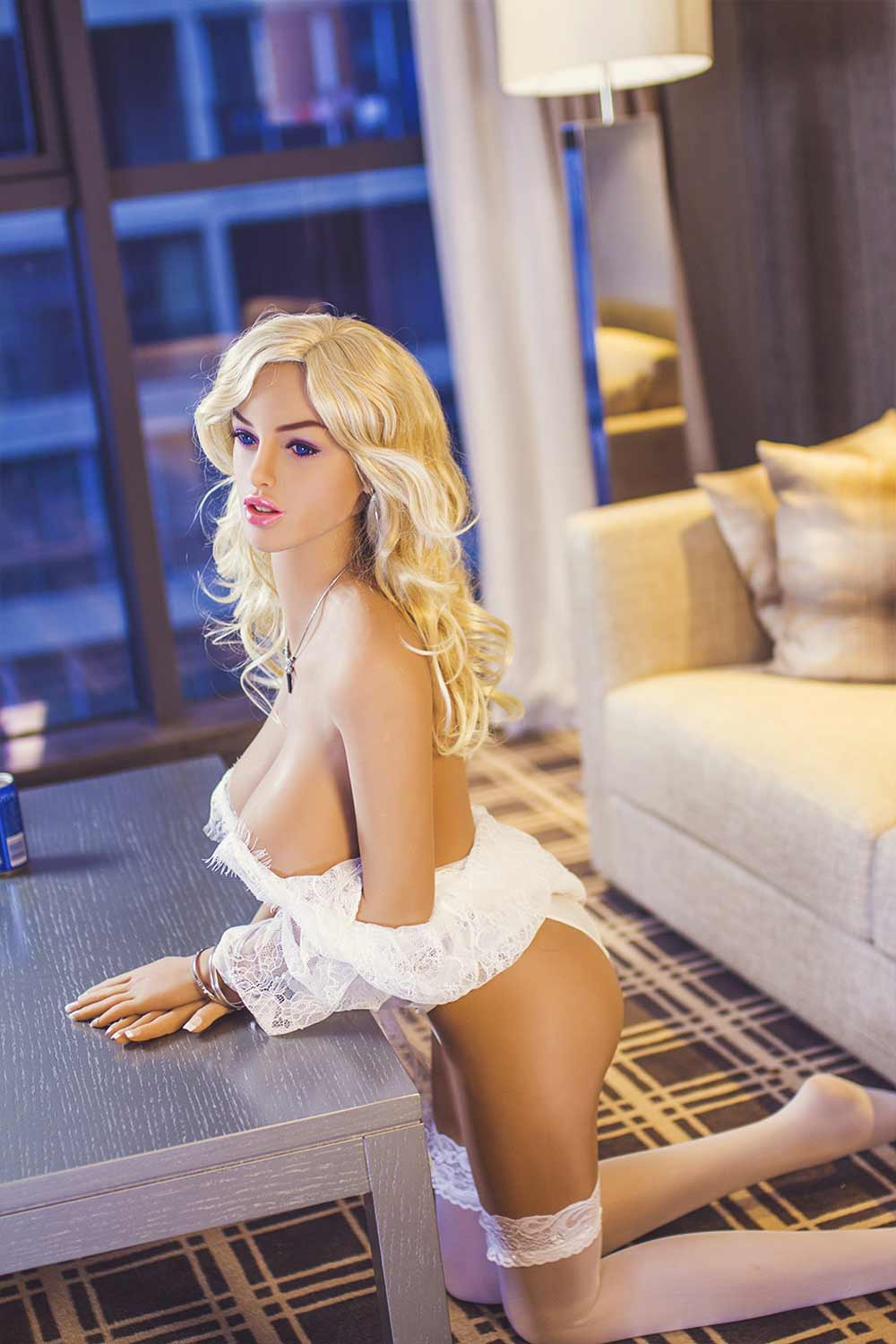 Sex doll with legs kneeling on the ground