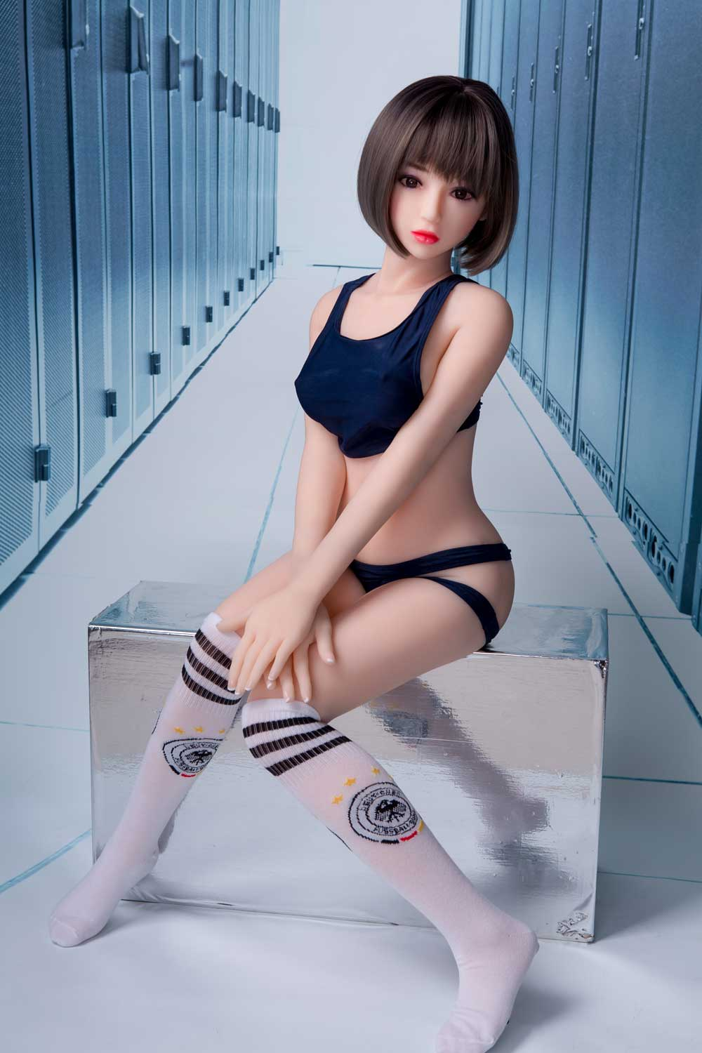 Sex doll with hands on knees