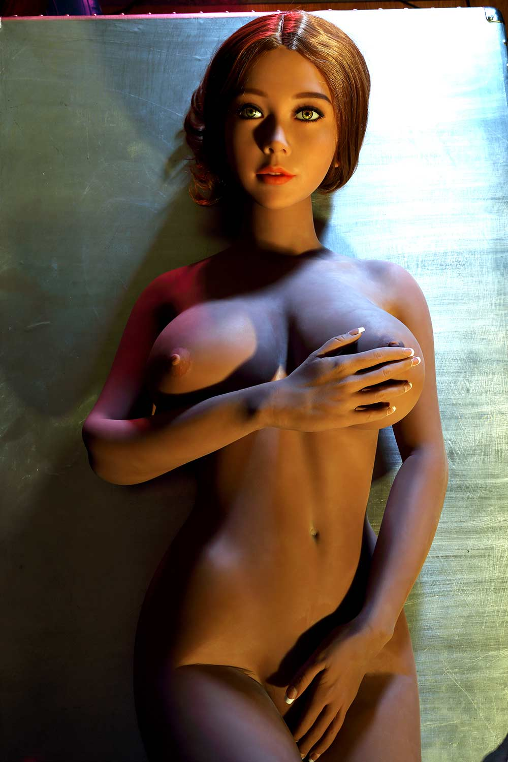 Sex doll with one hand covering the breast