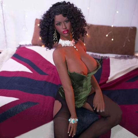 Black sex doll sitting on the bed with hands on thighs