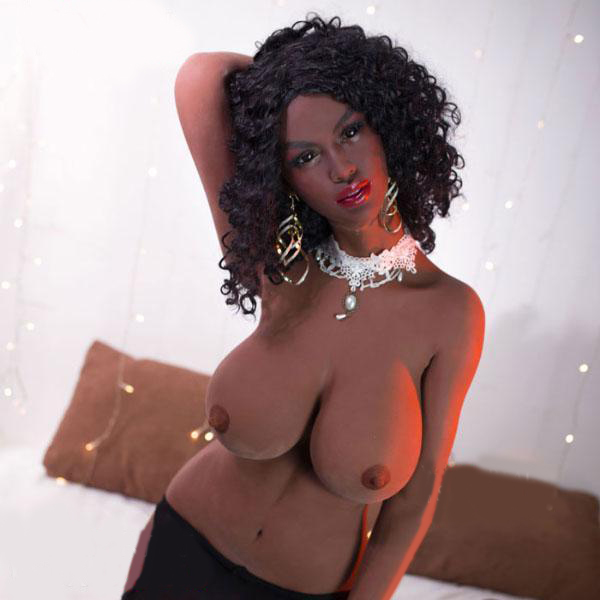 Black sex doll with hands reaching behind