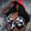Black sex doll with red hat in hand